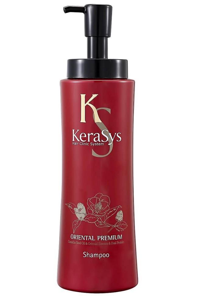 KeraSys Шампунь для волос Oriental восстанавливающий поврежденные волосы и укрепляющий корни (600 мл)KeraSys<br>Какими бы сильными и здоровыми волосами не наделила бы нас природа, их привлекательность без полноценного ежедневного ухода не возможна. Шампунь KeraSys Oriental Premium – продукт известного корейского бренда, способный удовлетворить требования даже самой взыскательной дамы. Это идеальное сочетание традиционного восточного подхода к изготовлению косметики и инновационных технологий современности.  Регулярное использование такого шампуня подарит вашим волосам здоровый блеск, упругость, шелковистость и максимальную увлажненность. Шампунь для волос KeraSys Oriental Premium порадует вас легкостью и экономностью применения. Кроме того, он обеспечивает:    кондиционирующий эффект, увеличивающий волосы в объеме и обеспечивающий легкость их расчесывания;  укрепление волосяных луковиц и защиту кутикулы;  устранение сухости локонов;  шелковистость и непревзойденный здоровый вид вашей прически;  лечение и профилактику выпадения волос и стимуляцию их активного роста.  Oriental Premium от Керасис оказывает благотворное влияние на волосы, пересушенные и поврежденные постоянными окрашиваниями и другими не щадящими процедурами.    За время своего существования на рынке стран СНГ высокоэффективный натуральный шампунь для волос KeraSys Oriental Premium отзывы заслужил исключительно положительные. Наличие в его составе целого комплекса чудодейственных травяных экстрактов обеспечивает максимальное питание волос. Натуральные экстракты женьшеня, орхидеи, граната, жгун-корня, листьев камелии, а также ангелики насыщают волосы полезными витаминами и минералами.  По отзывам потребителей, шампунь Керасис Oriental Premium отлично увлажняет локоны, предотвращает выпадение и стимулирует рост новых волос. Основным действующим компонентом данного косметического средства является масло камелии. На шампунь для волос KeraSys отзывы подтверждают, что натуральное растительное масло проникает 