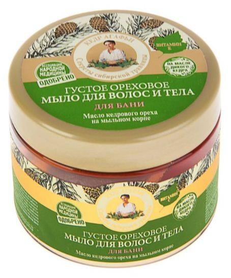 Рецепты Б.Агафьи Мыло для волос и тела для бани ореховое 300 мл.Рецепты Бабушки Агафьи<br>Ароматное ореховое мыло варится по старинной сибирской рецептуре с добавлением натуральных масел кедра, лесного ореха и экстракта мыльного корня. Эффективность природных компонентов, входящих в состав мыла, усиливается при использовании в бане. Мыльный корень бережно очищает волосы и кожу, не нарушая естественного баланса. Масло сибирского кедра обладает восстанавливающим действием, интенсивно питает и увлажняет кожу и волосы. Масло лесного ореха превосходно смягчает волосы и придает коже нежный аромат. Экстракт шишек чёрной ольхи обладает антибактериальным и антисептическим свойствами, придавая свежесть надолго.Объем 300 мл<br><br>Вес г: 350<br>Бренд : Рецепты Б.Агафьи<br>Объем мл: 300<br>Страна производитель : Россия